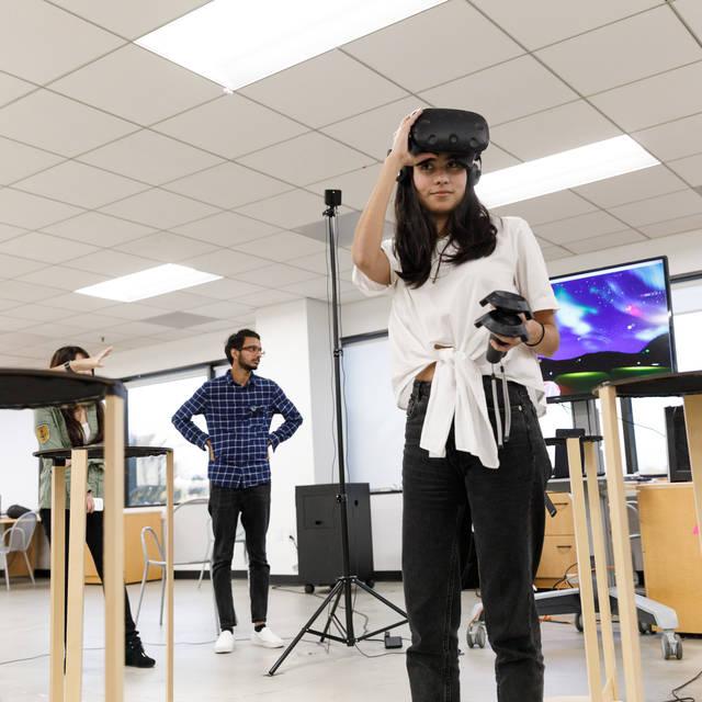 Student raises her VR device
