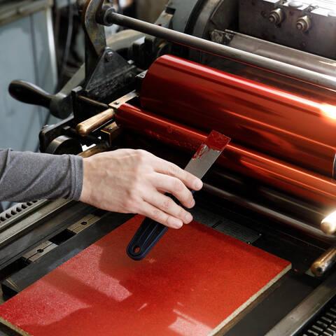 hand applying ink to vandercook letterpress