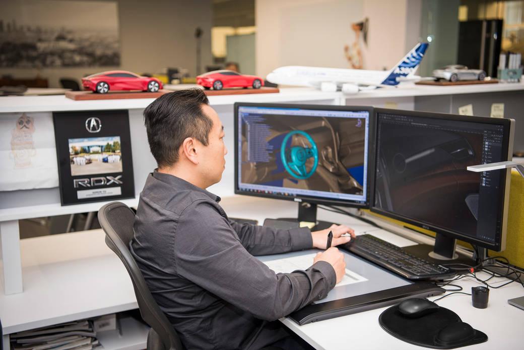 ArtCenter alumnus and Acura Lead Interior Designer Simon Yu working at the Acura Design Studio in 2019