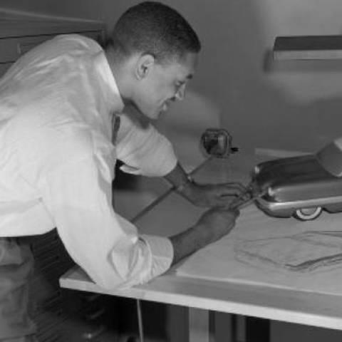 /Thompson working on a drawing (via wardsauto.com).
