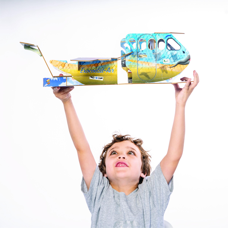 Boy plays with Archamelia airplane.