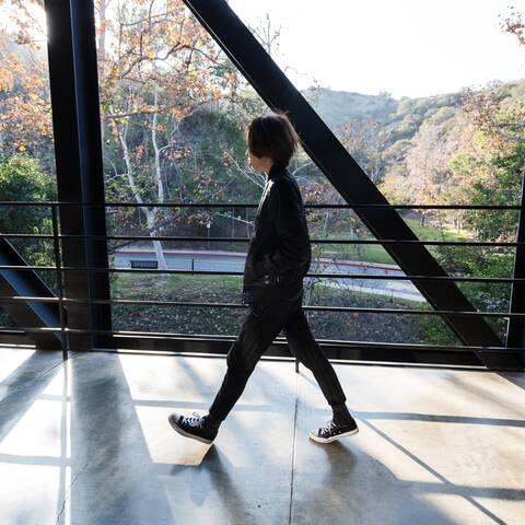 student walking across the ArtCenter bridge
